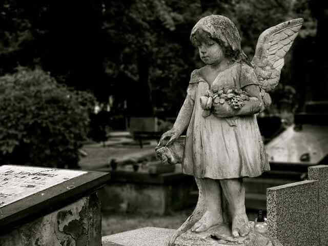 Angel statute in a graveyard. Health insurance mergers spells disaster for YOUR healthcare costs