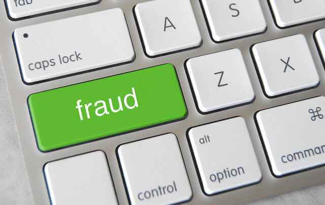 """A green """"fraud"""" key on a keyboard. Fraudulent applications are just one part of the problem behind the 3rd party healthcare payment system we use"""