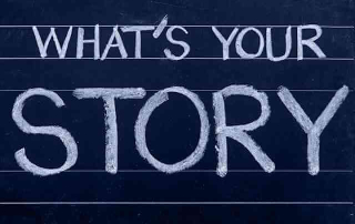 """""""What's Your Story"""" written on a chalk board. Sovereign Money Solutions' name has a story to it."""