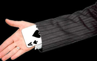 Picture of a playing card up a sleeve. Vanity & magic in Single Payer Healthcare!