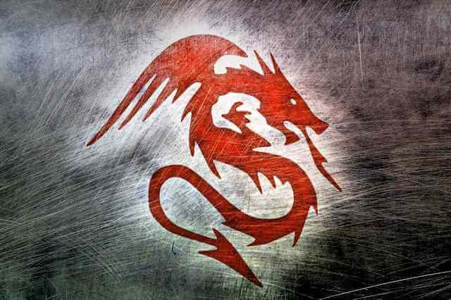 Picture of red winged dragon over darkened background.