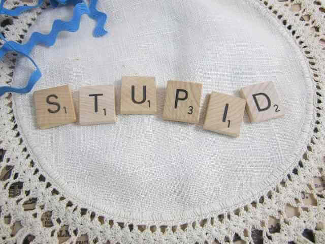 "Picture of Scrabble letters spelling out ""STUPID"" on a table cloth. The calls for Universal Basic Income are from the usual sources that continue to degrade human potential and existence. ""We"" are being quite stupid for not resisting and resoundingly calling out the cynical move towards establishing a new slavery."