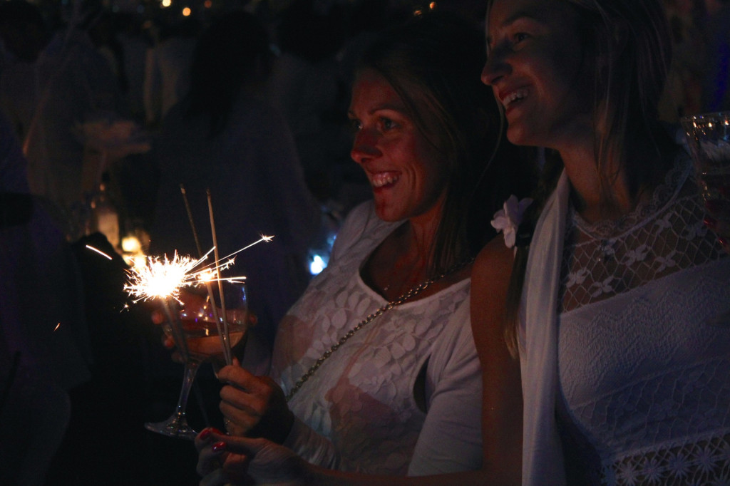 Celebrating at Diner en Blanc. Photo by Annie Shreeve