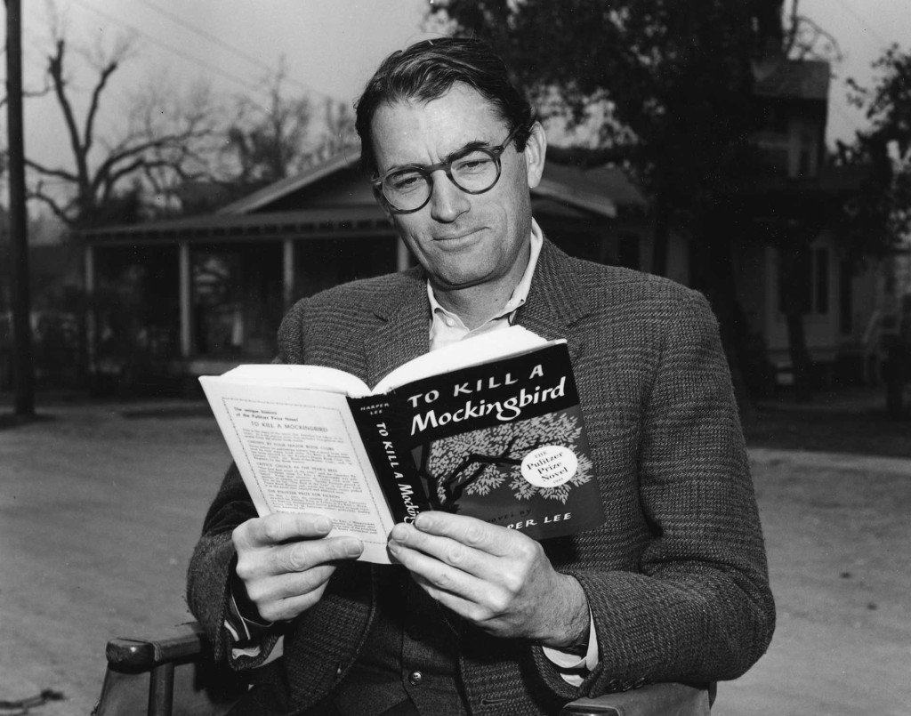 """Gregory Peck, the actor that portrayed Atticus Finch in the 1962 movie adaptation of """"To Kill a Mockingbird"""", reading the novel. Source: Academy of Motion Picture Arts and Sciences."""