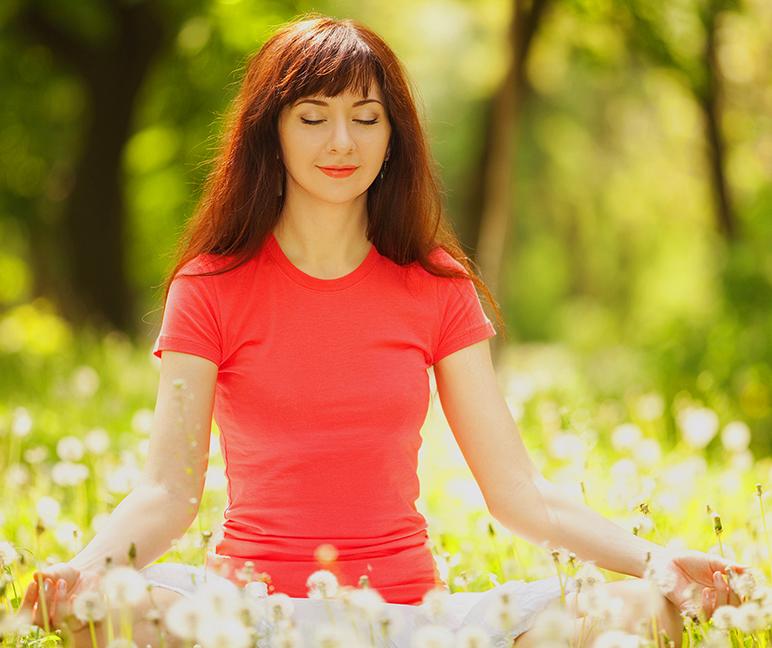 girl meditating in the field