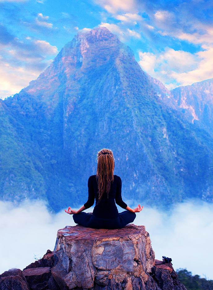 girl meditating on mountaintop