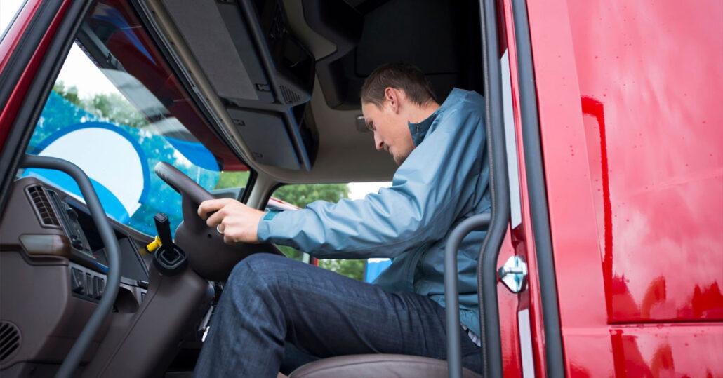 Man driving an 18-wheeler truck