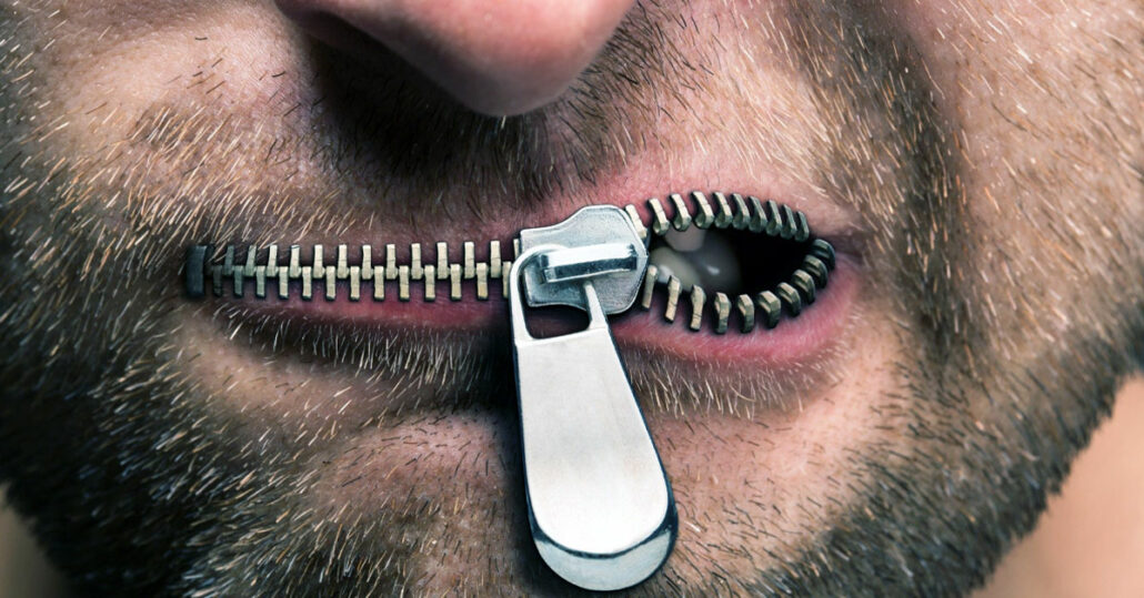 Man with a half-closed zipper for lips
