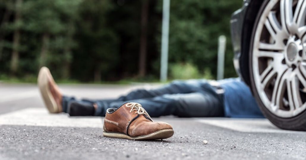 Man lying dead in the road after being struck by a vehicle