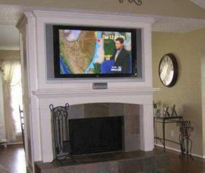 Fireplace mantel enclosure built in tv