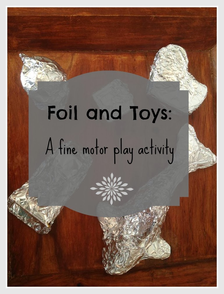Foil and Toys: Toddler fine motor activity