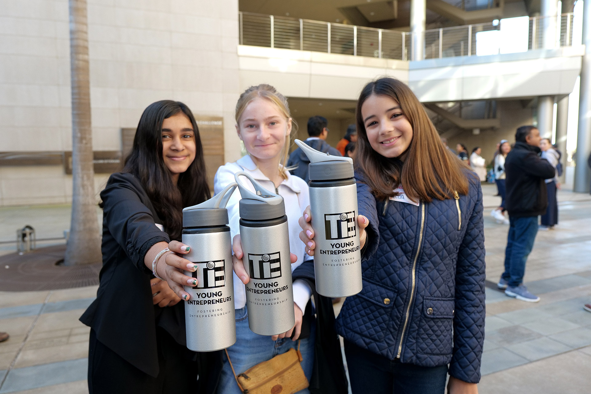 Three female TYE students with water bottles