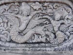 Stucco figures on the ho trai of Wat Phra Singh, Chiang Mai, Thailand.