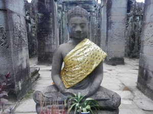 A relatively new Khmer type Buddha statue in the Bayon, Angkor, Cambodia