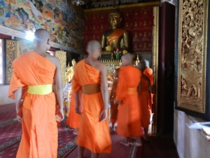 Monks in Wat Mahathat, Luang Prabang, Laos.