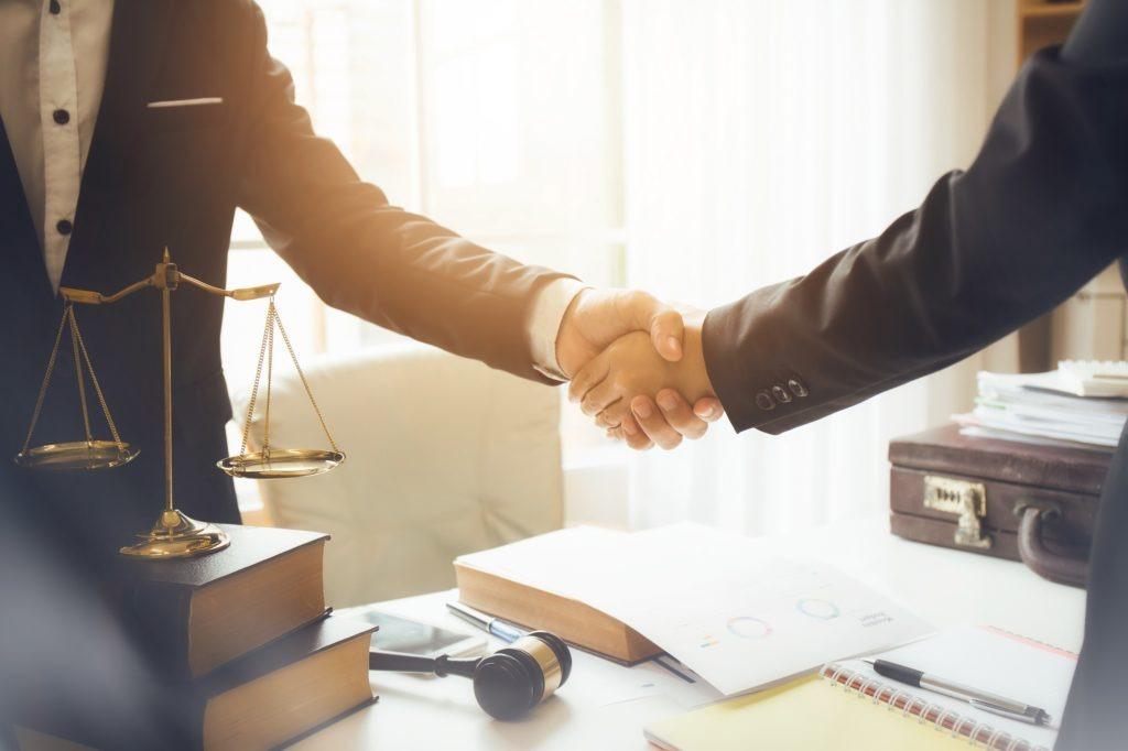 Handshake between attorneys and clients