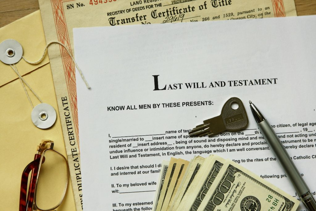 last will and testament with 100 dollar, transfer certificate and key