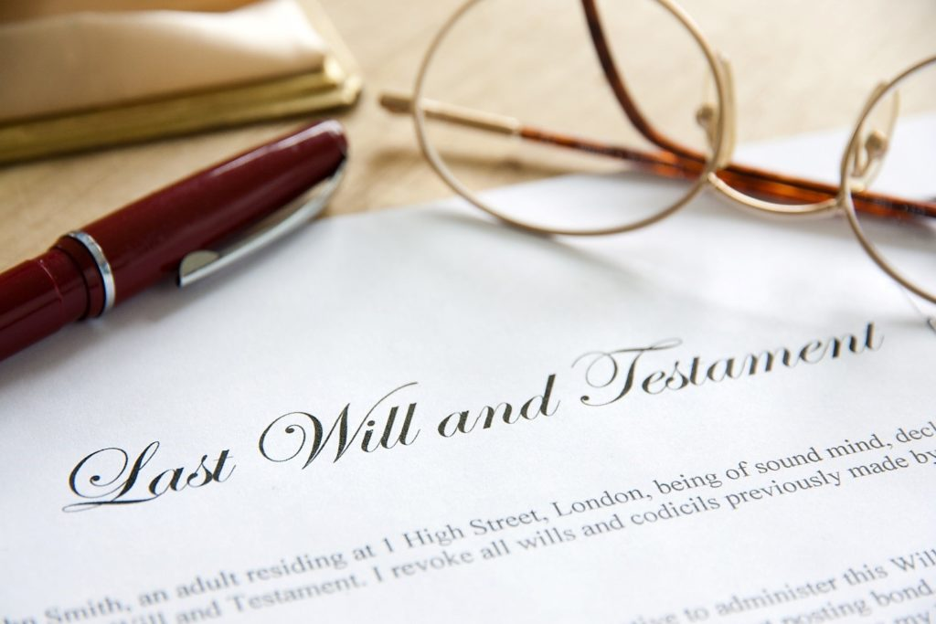 Last will and testament papers with pen and glasses