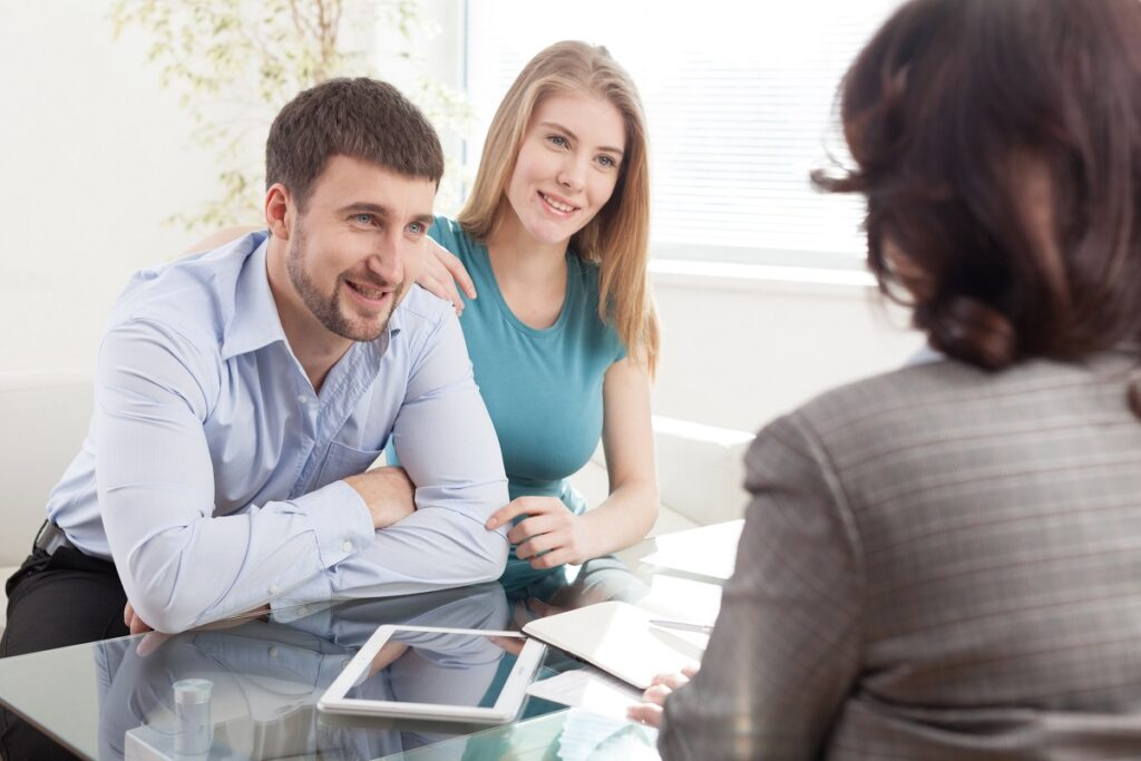 happy Couple planning investment With Financial Consultant