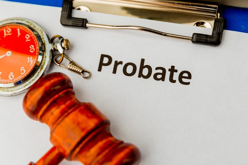 Probate on clipboard with gavel and stopwatch