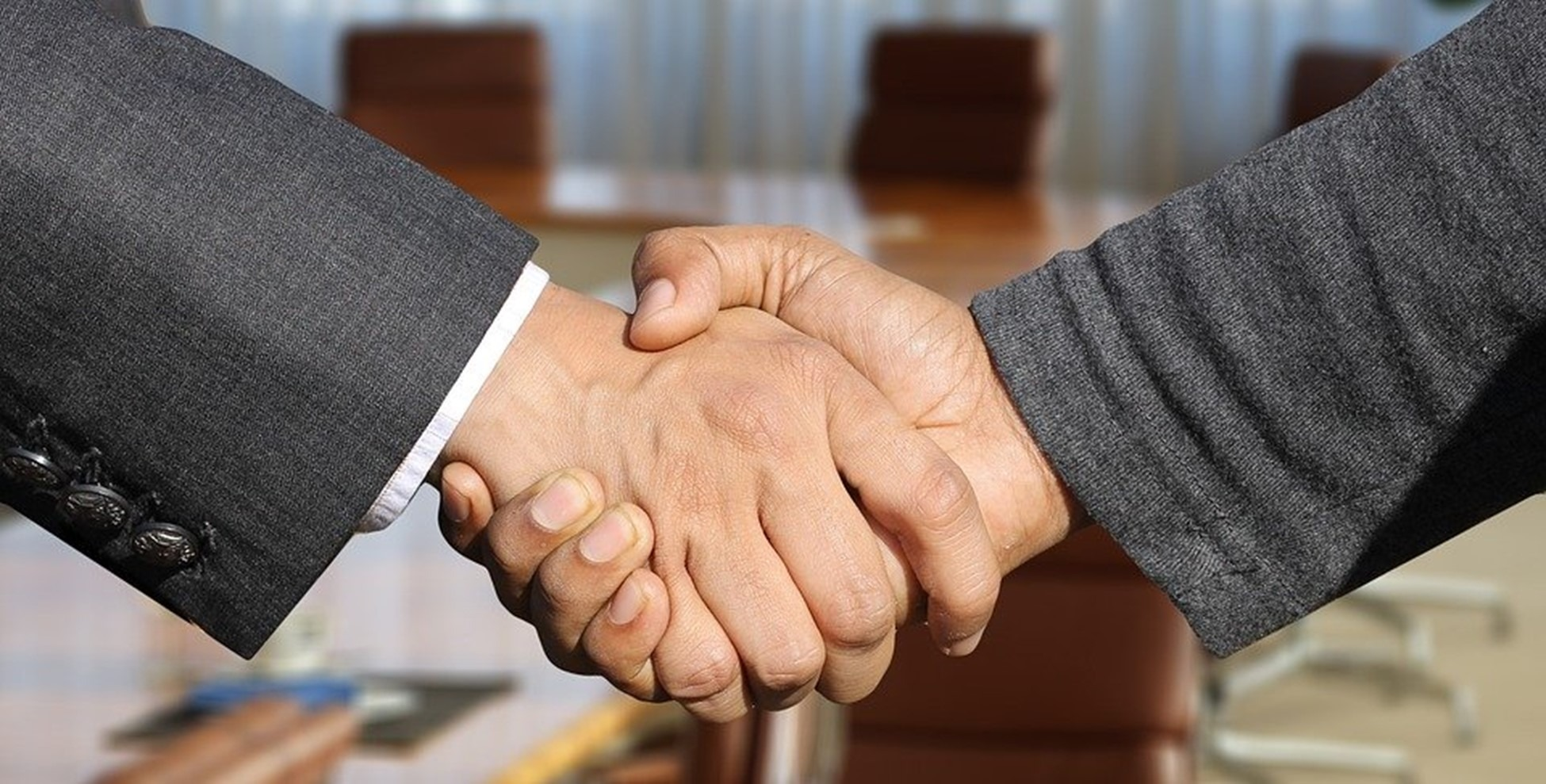 Person shaking hands with an estate attorney representing a successful collaboration