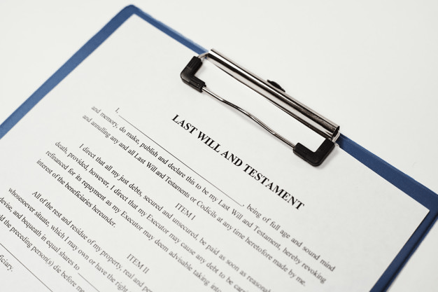 A sample of last will and testament with a section about debt payment.