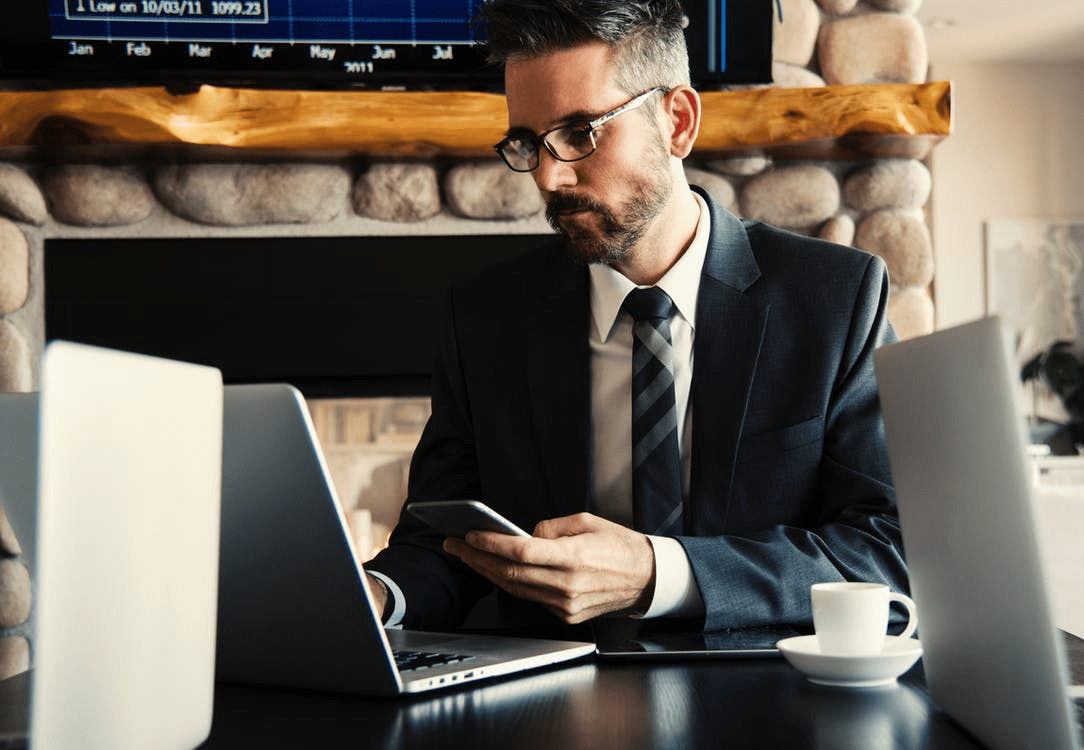 A lawyer working with his laptop and phone.