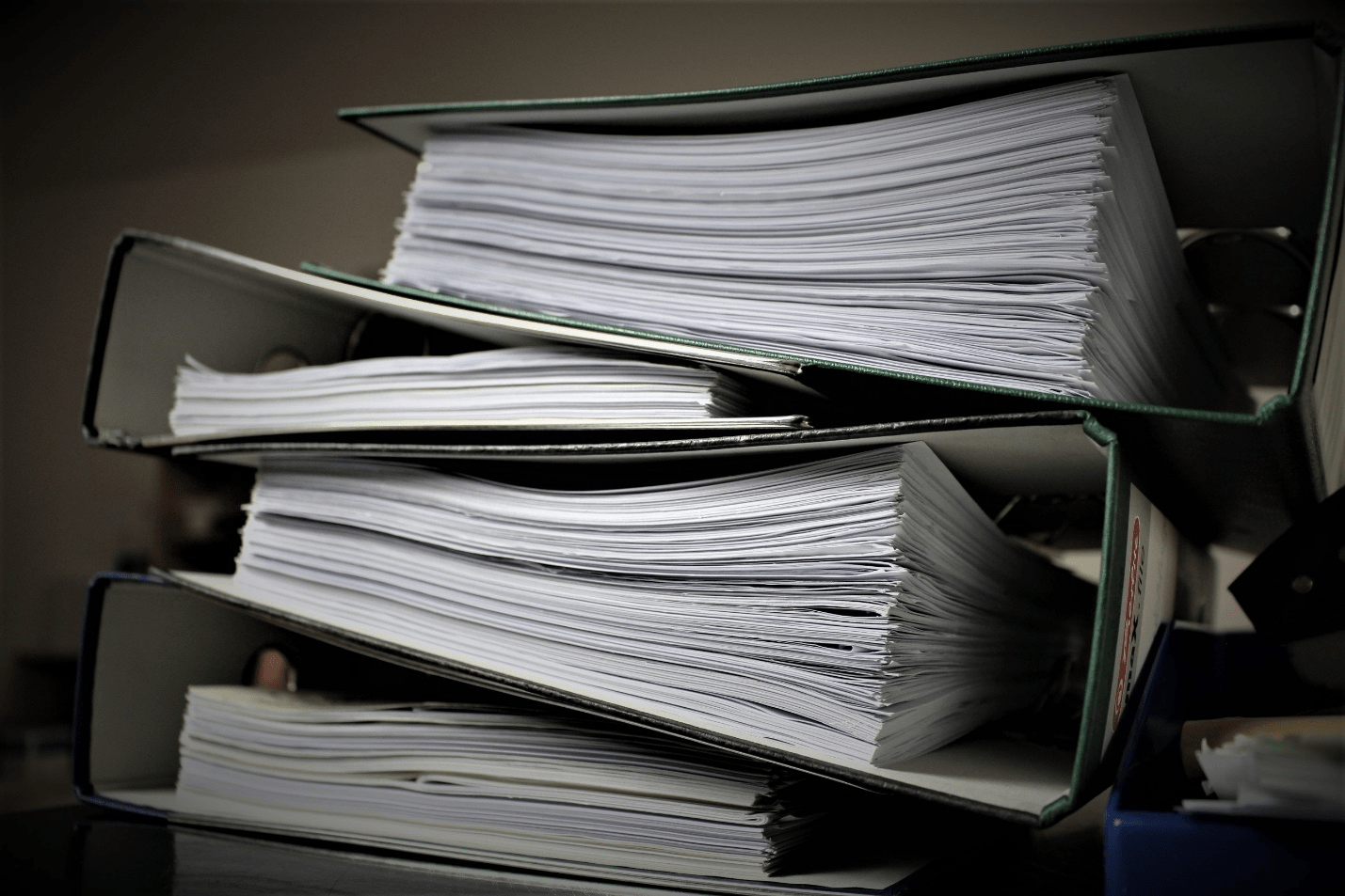 A Pile of Folders with Paperwork