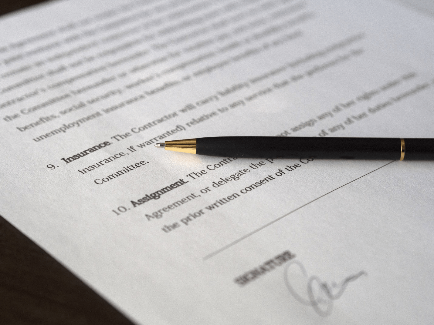 A signed document with a pen