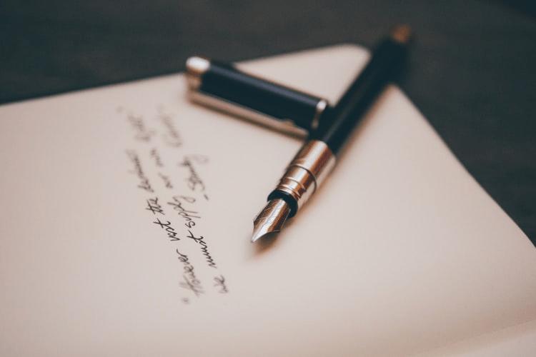 a fountain pen written statement on a paper