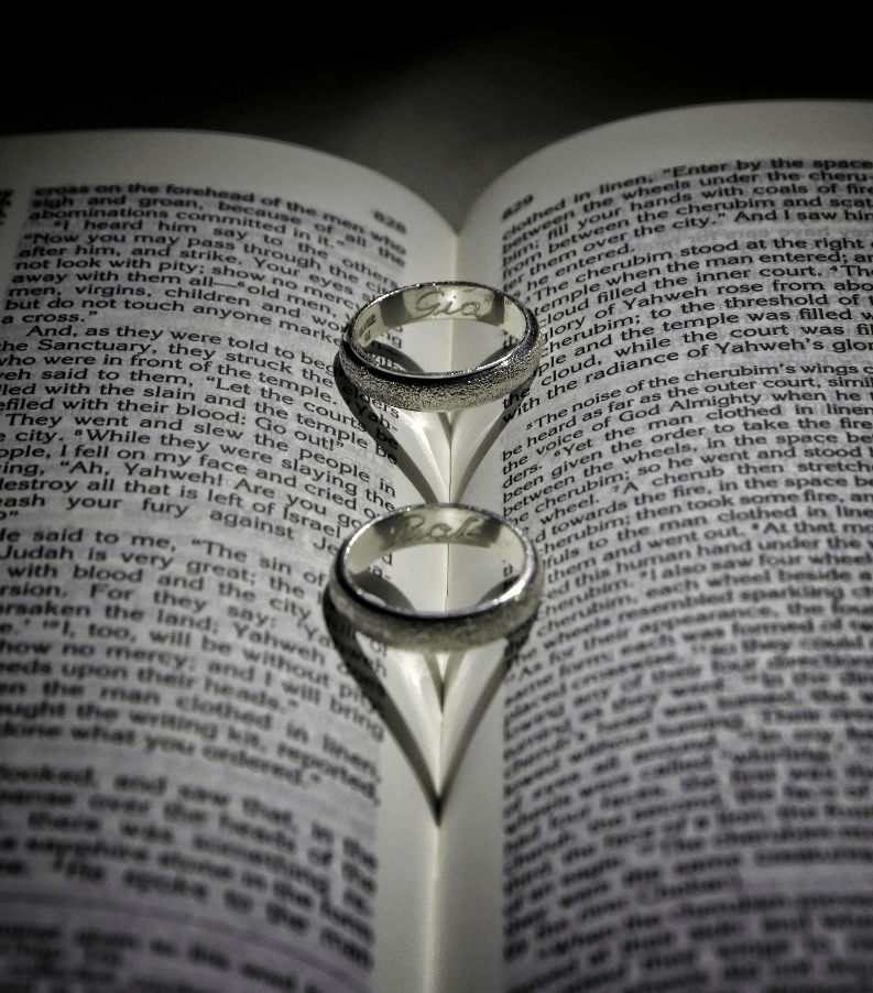 Wedding rings inside a book.