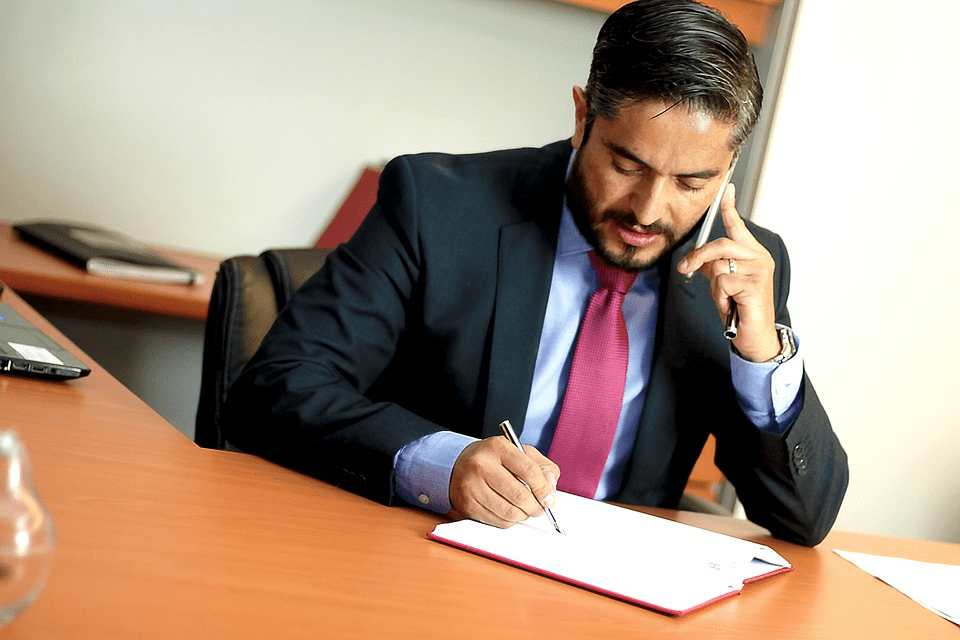 An attorney consulting with a client on the phone