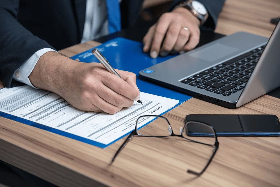 A man writing guardianship clauses in his Will
