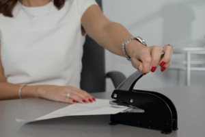 A notary putting a professional seal on a legal document