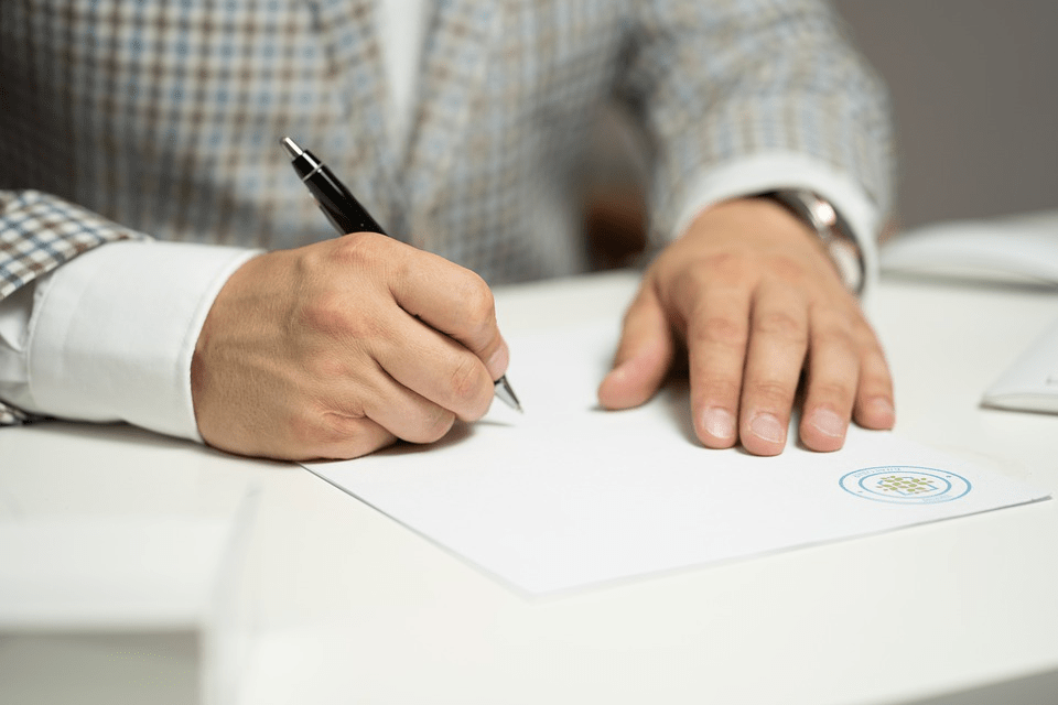 A person signing an important document