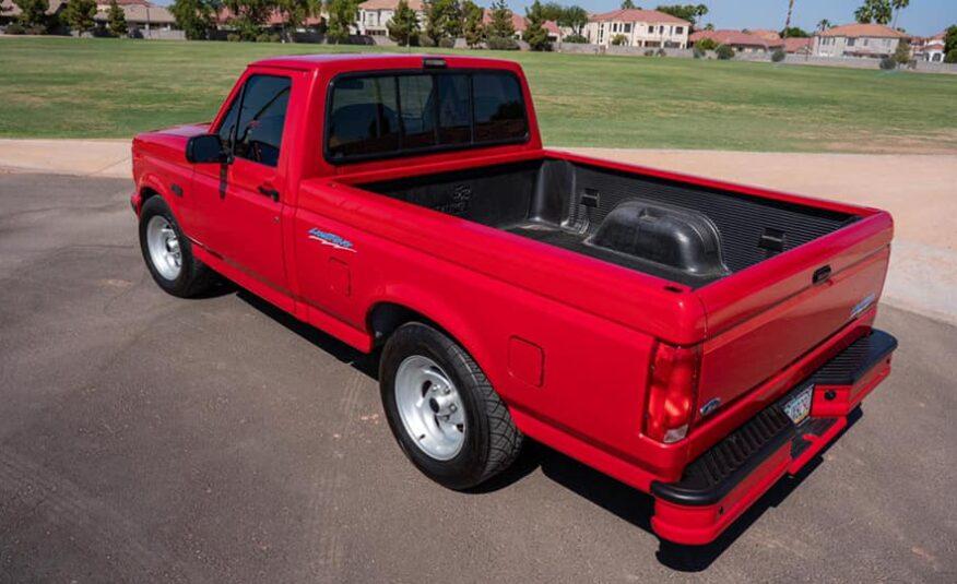 1993 RED FORD LIGHTNING ( 33,000 miles )