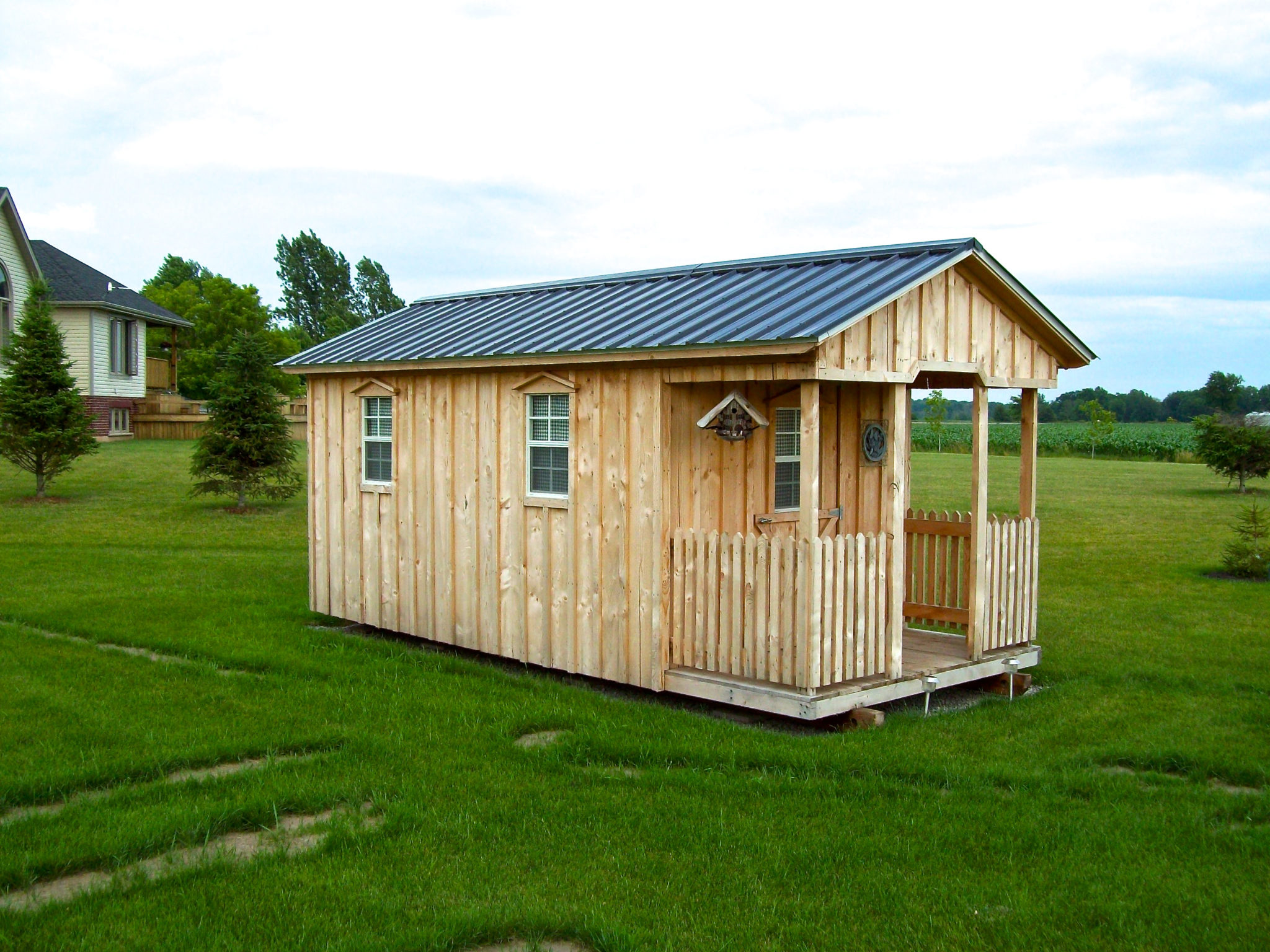 Amish Shed with porch and green roof