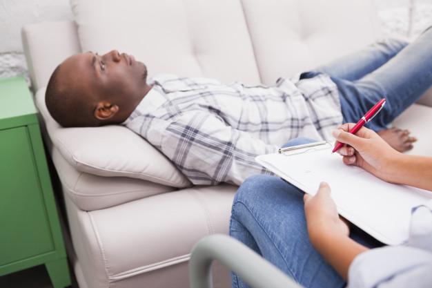 man-lying-sofa-talking-his-therapist_13339-73529