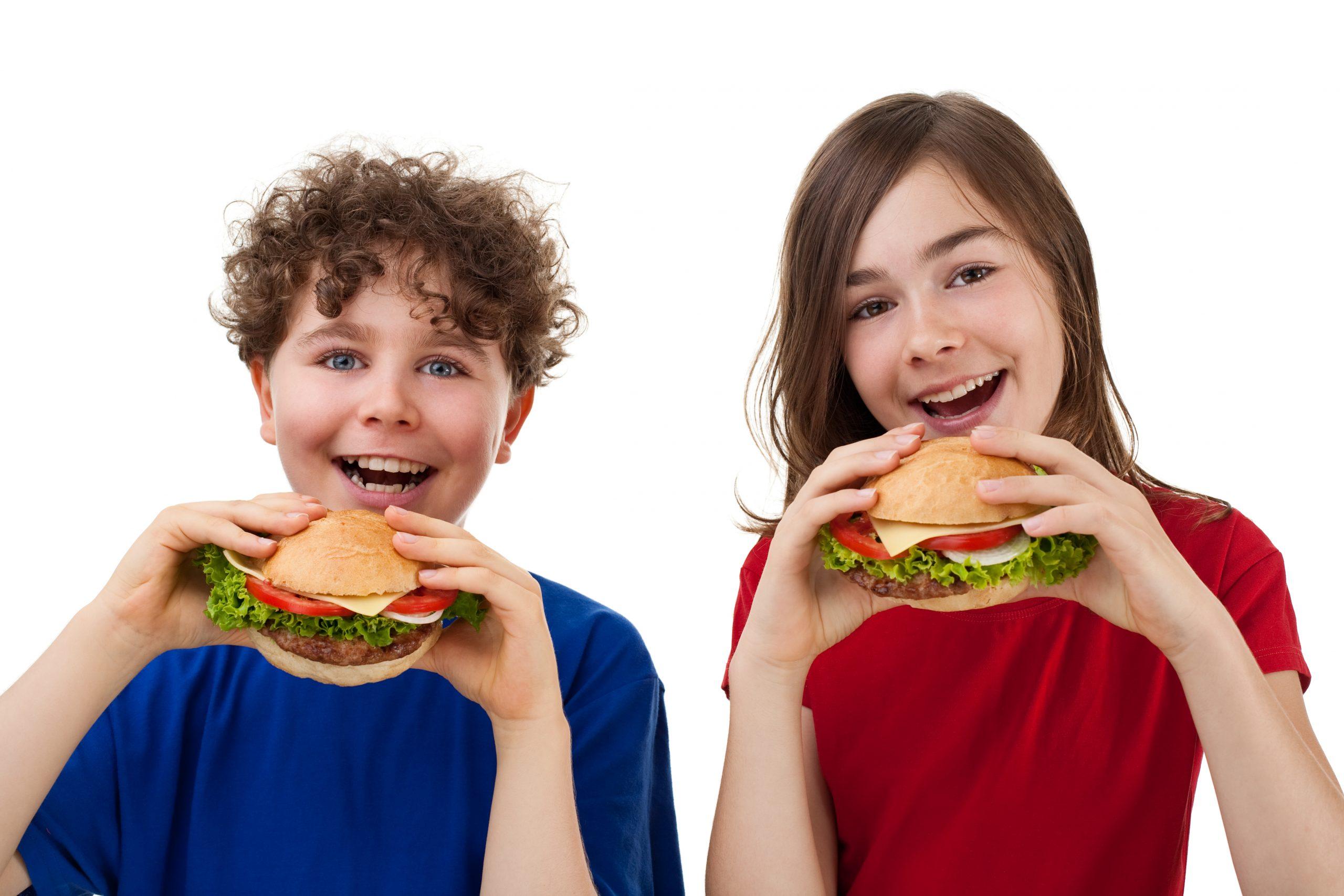 Kids eating burgers