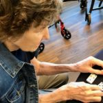 Assistive Living Facility Member using Dominos with Large Print