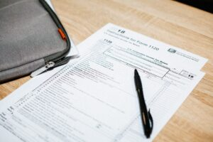 tax documents on table with pen