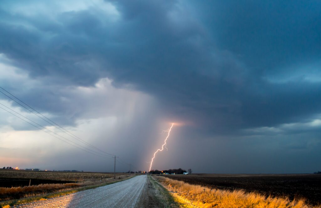 lightning striking ground in countryside
