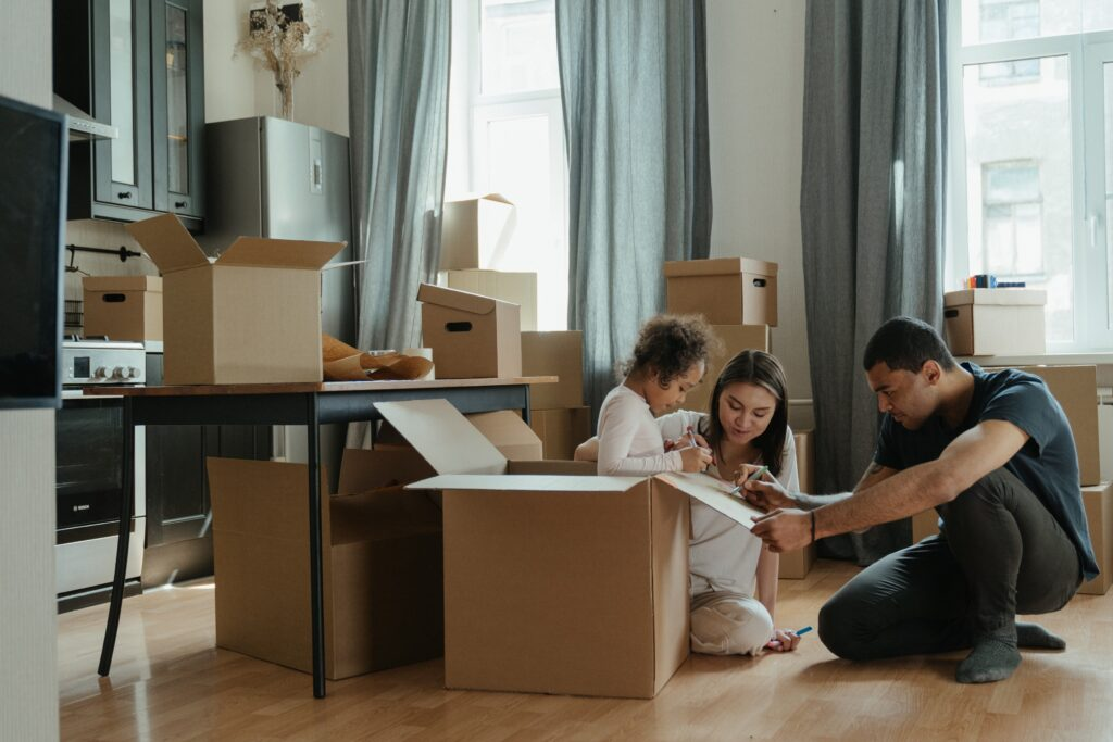 family packing boxes to move