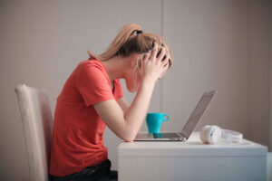woman frustrated in front of laptop