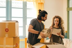 couple looking at checklist to move out