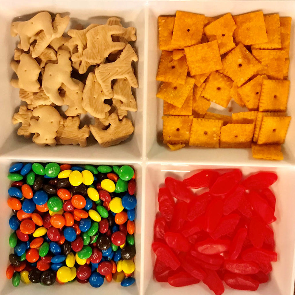 """The York family tackles a game of Apples to Apples and enjoys a snack assortment including the """"Connect Four,"""" also seen below."""