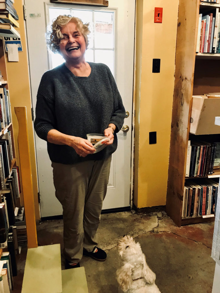 Melinda McGrath is helped by Toby the store dog.