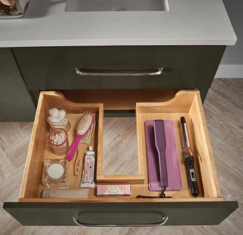 kraftmaid open drawer under vanity with toiletries and hairstyling products