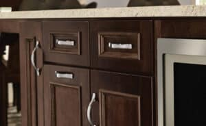 dark wood cabinets with brushed nickel hardware handles