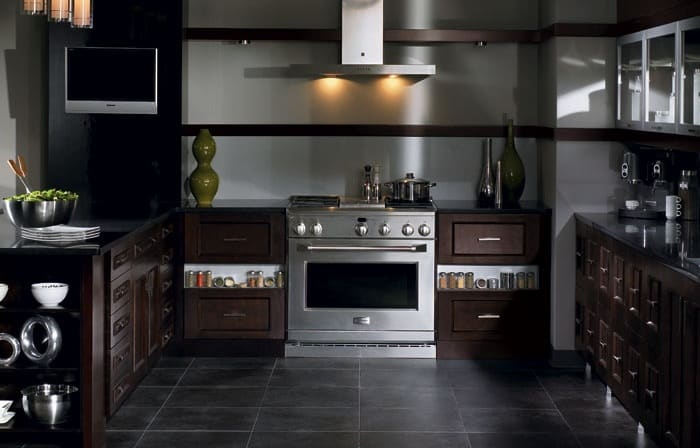 remodeled kitchen with dark, matte finishes on materials, cabinets, and appliance